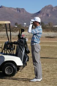Photo of Man using golf rangefinder